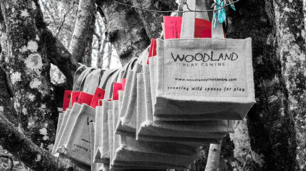Bespoke party bags hanging from a tree in the woods