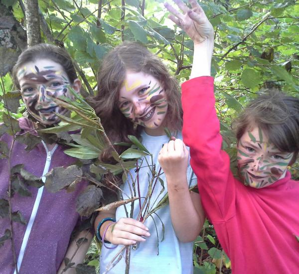 Children in camouflage in the woods