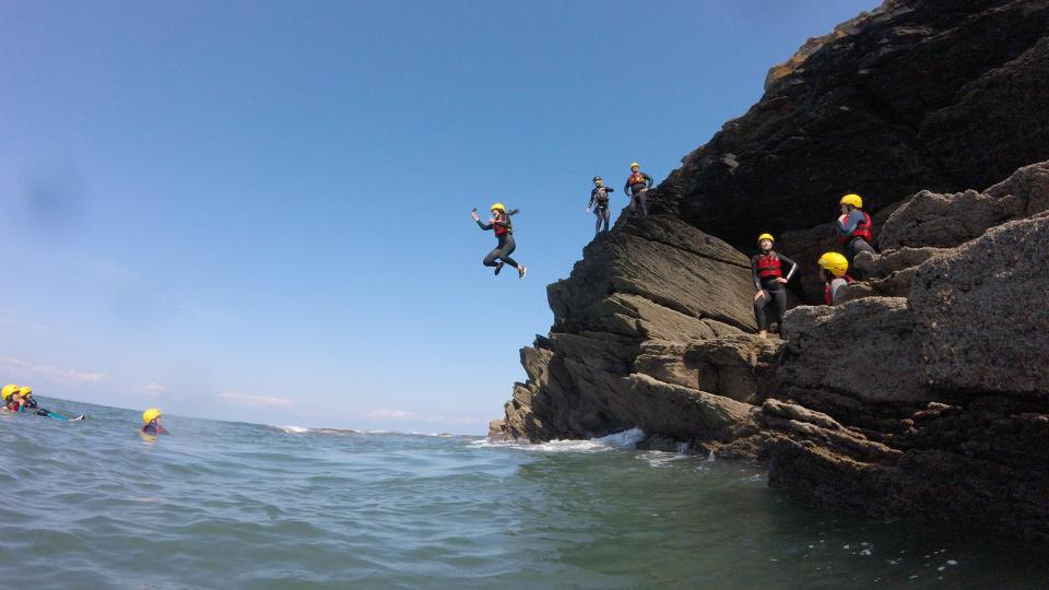 jumping off rock in to the sea